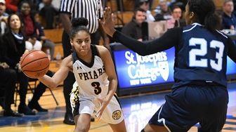 St. Anthony's guard Kayla Robinson passes the ball