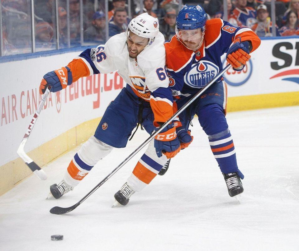New York Islanders' Josh Ho-Sang (66) and Edmonton