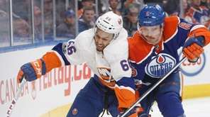 New York Islanders' Josh Ho-Sang (66) and Edmonton