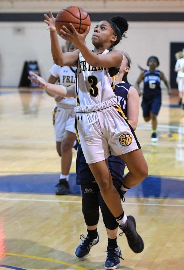 St. Anthony's guard Kayla Robinson is fouled by