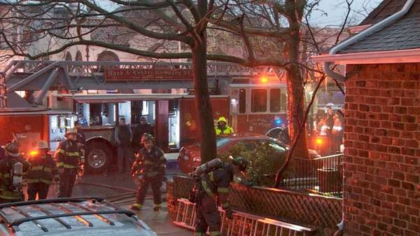 Five firefighters were injured battling an early morning