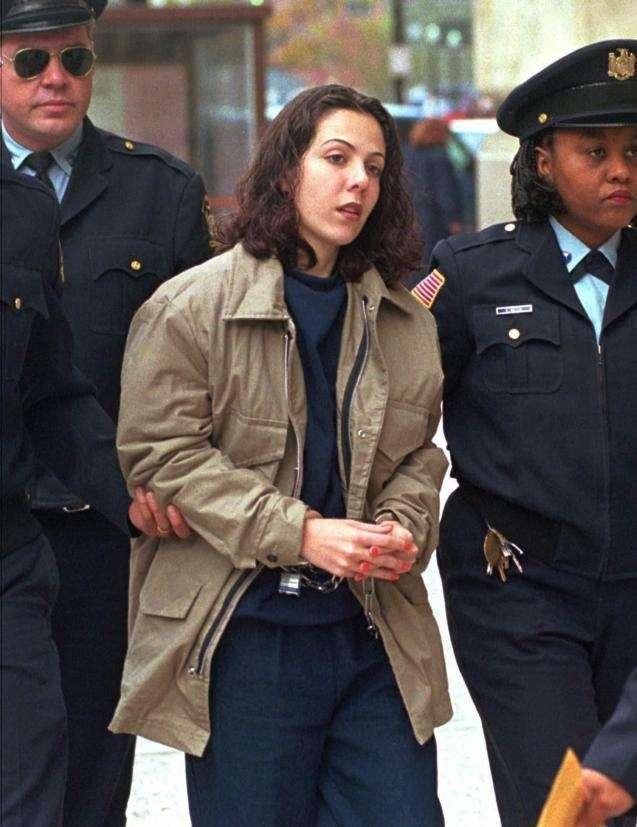 Amy Fisher is escorted into the federal courthouse
