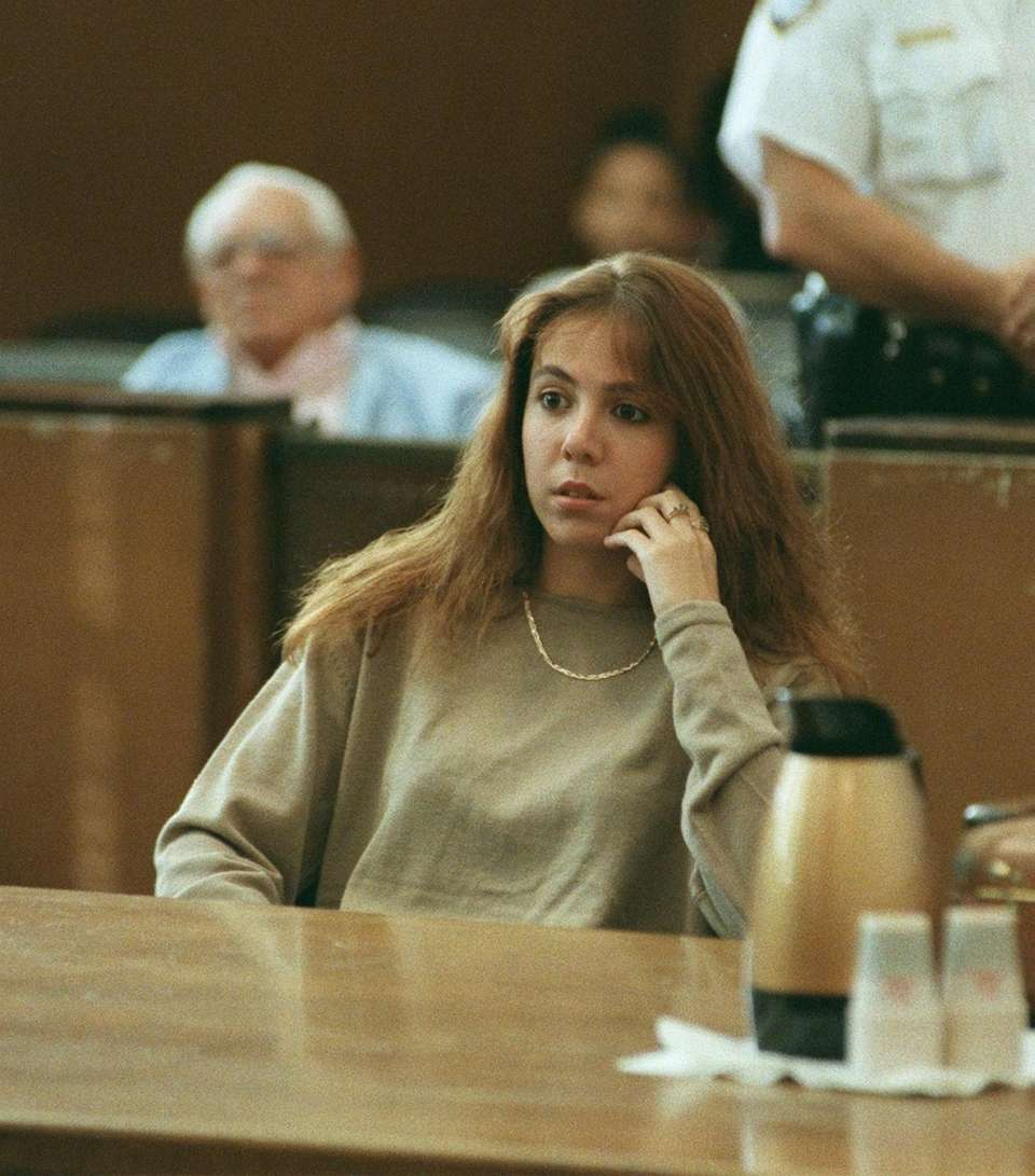 Amy Fisher sits in Nassau County Court while