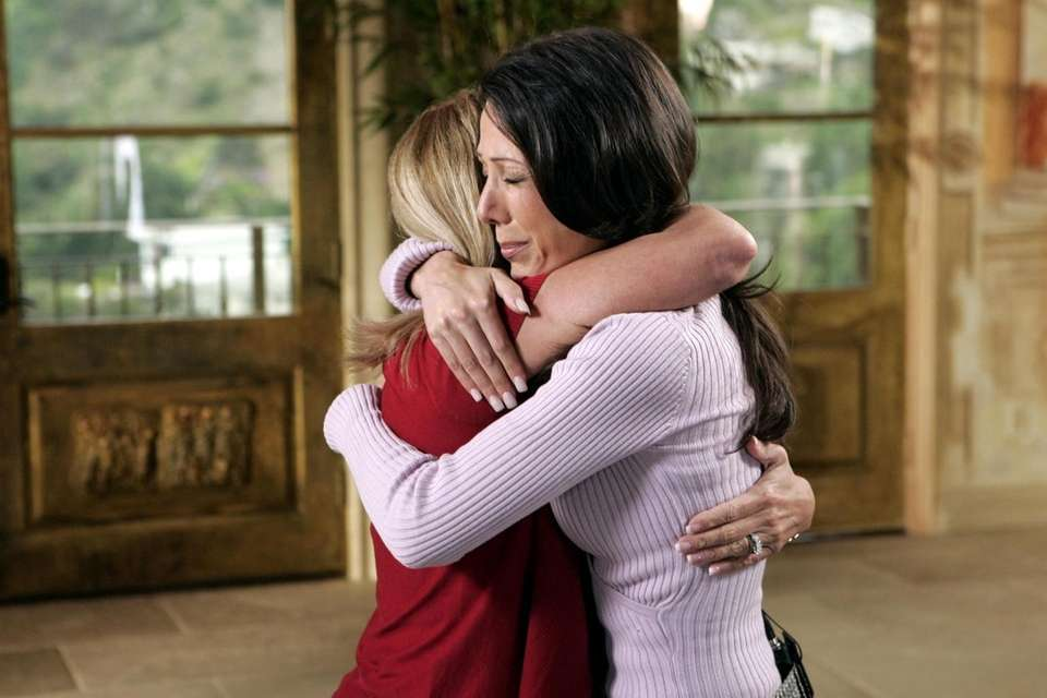 Mary Jo Buttafuoco, left, and Amy Fisher embrace