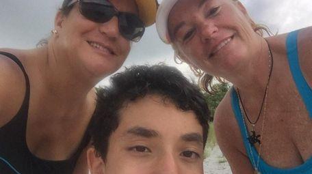 Arlette Clark-Bustamante, left, with her son, Austin, center,