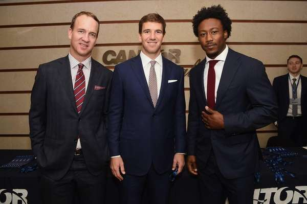 Peyton Manning, Eli Manning and Brandon Marshall attend