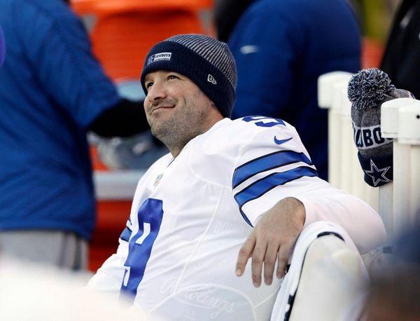 Dallas Cowboys' Tony Romo smiles on the bench