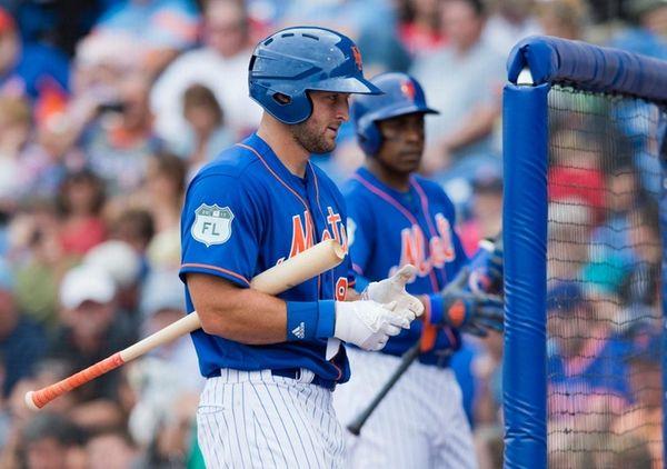 New York Mets designated hitter Tim Tebow walks