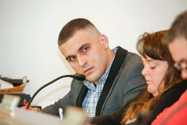Mastic Beach Village Board trustee Christopher Anderson listens