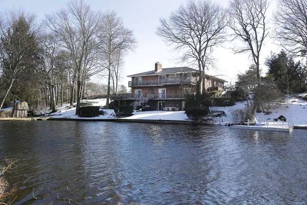 This five-bedroom home on a lake in Patchogue