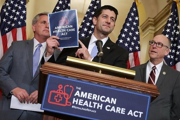 Speaker of the House Paul Ryan (R-Wisc.), center,