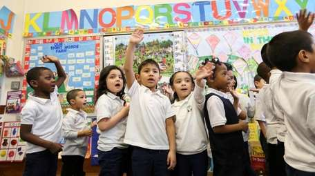 Students in a pre-K class sing a song