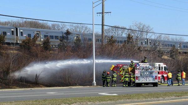 A brush fire along the Long Island Rail