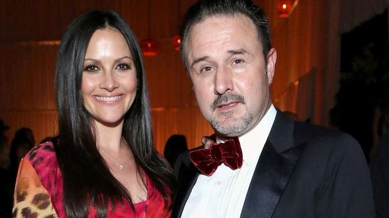 David Arquette, right, and his wife Christina McLarty