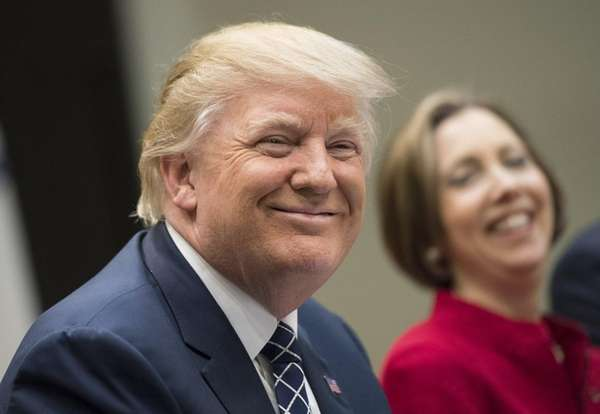 U.S. President Donald Trump smiles during a National