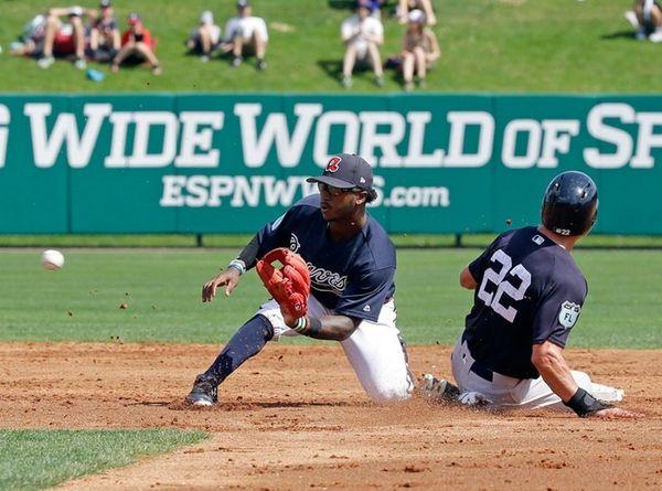 Atlanta Braves shortstop Ozzie Albies, left, waits for