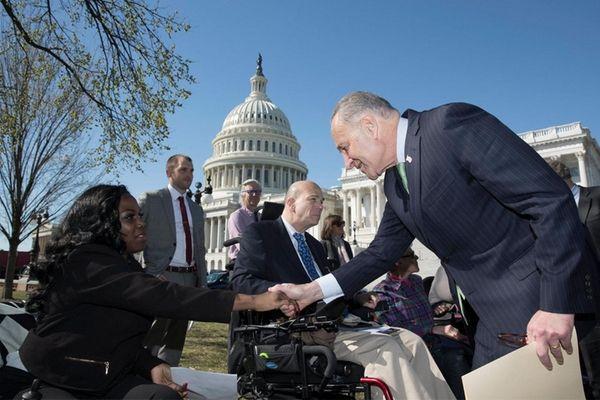 Senate Minority Leader Democrat Chuck Schumer, right, shakes