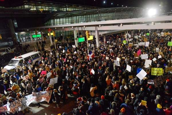 Protestors rally during a demonstration at Kennedy Airport