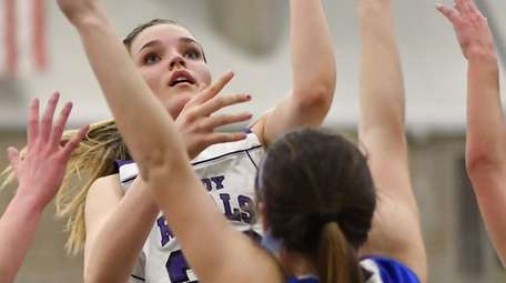 Courtney Lewis #20 of Port Jefferson drives to