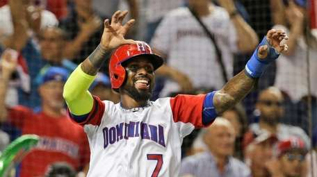 Dominican Republic's Jose Reyes celebrates after scoring on
