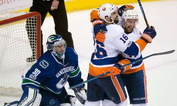 Vancouver Canucks goalie Ryan Miller waits as New