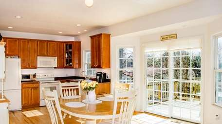 The kitchen and deck access from this four-bedroom