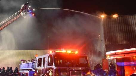 Firefighters battle a blaze at the former Lawrence