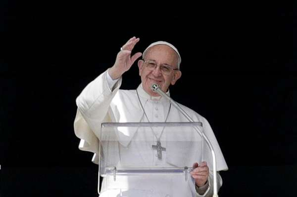 Pope Francis waves to faithful in St. Peter's