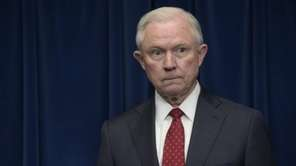 Attorney General Jeff Sessions waits to make a