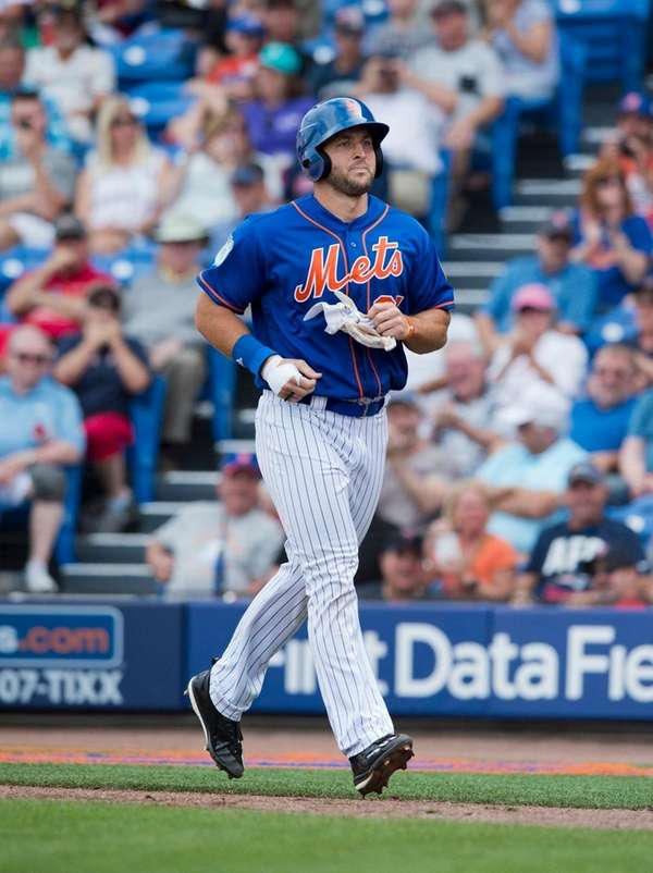 Mets designated hitter Tim Tebow makes his way