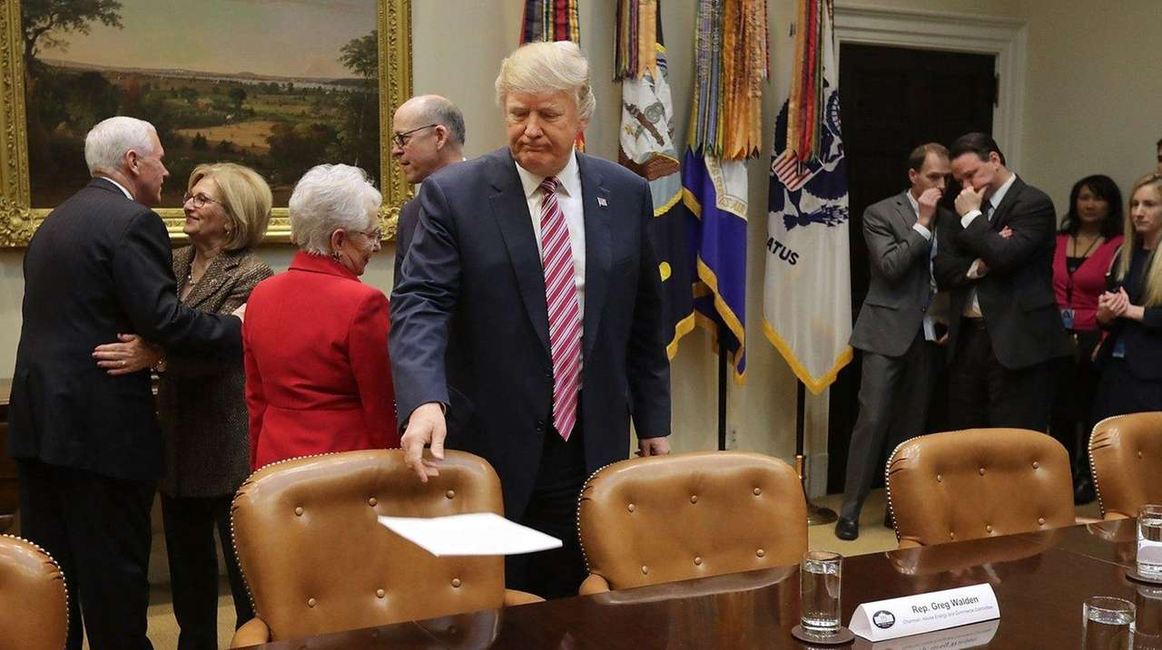 U.S. President Donald Trump sets down his remarks