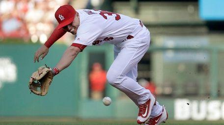 St. Louis Cardinals shortstop Aledmys Diaz dives for