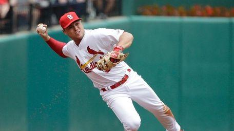St. Louis Cardinals shortstop Aledmys Diaz throws to