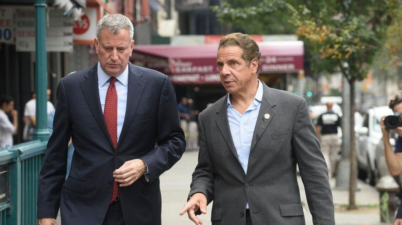 New York City Mayor Bill de Blasio, left,