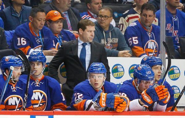 Islanders head coach Doug Weight looks on in