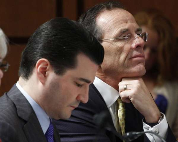 Dr. Scott Gottlieb, left, is seen on Capitol