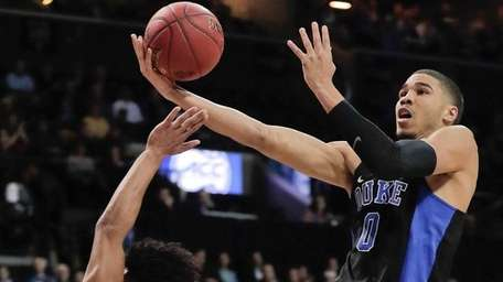 Duke forward Jayson Tatum (0) goes up for