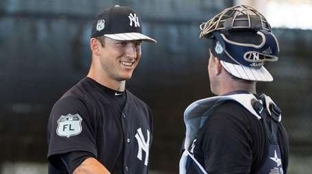 Yankees' pitcher James Kaprielian shakes hands with the