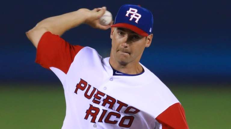 Seth Lugo, #67, of Puerto Rico pitches in