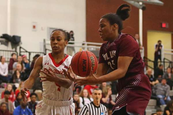 Kamala Thompson, right, of Molloy battles for the ball