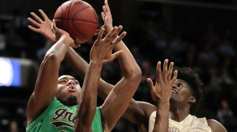 Notre Dame forward Bonzie Colson (35) puts up