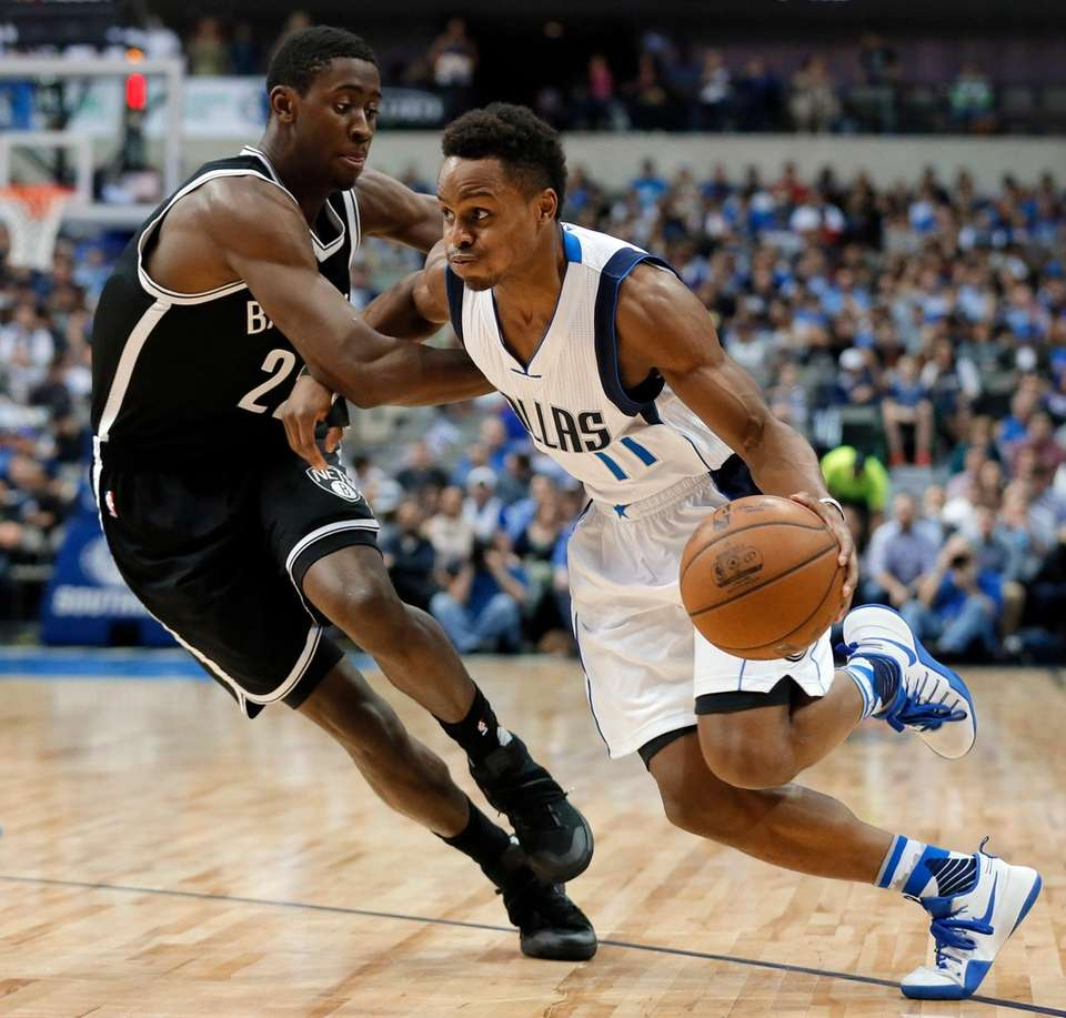 Brooklyn Nets' Caris LeVert (22) defends as Dallas