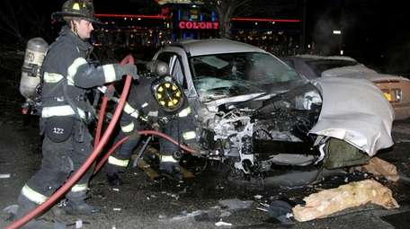 Firefighters respond to a single-car crash early Saturday,
