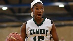 Zhaneia Thybulle #15 of Elmont surveys the court