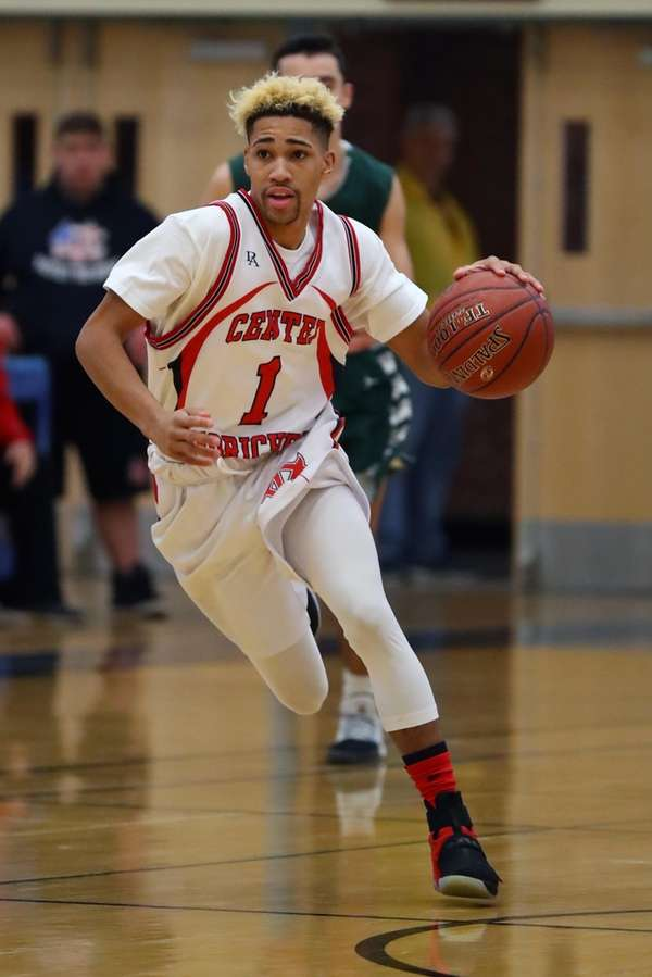 Tyiquon Nix #1 of Center Moriches drives up