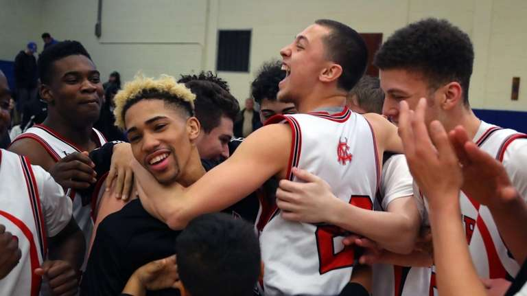 Center Moriches players celebrate after their 72-57 victory
