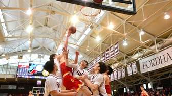 Players battle for a rebound during the Catholic