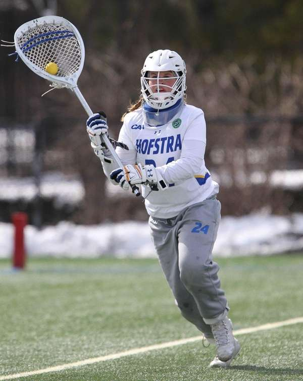 Hofstra goalie Maddie Fields (24) looks to clear