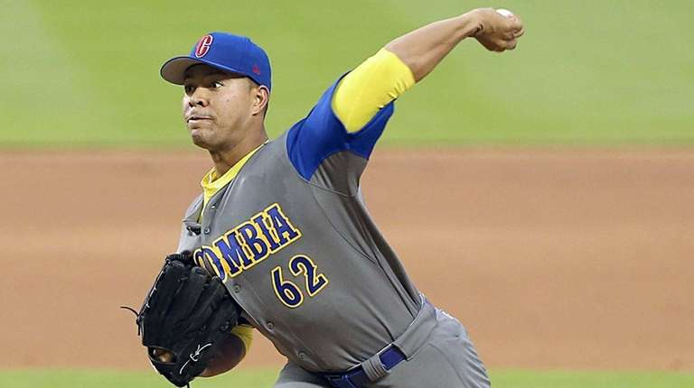 Colombia's Jose Quintana pitches in the first inning