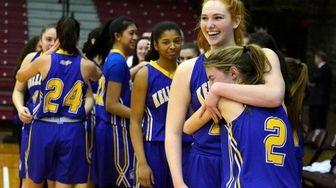Kellenberg player Morgan Staab and her teammates celebrate